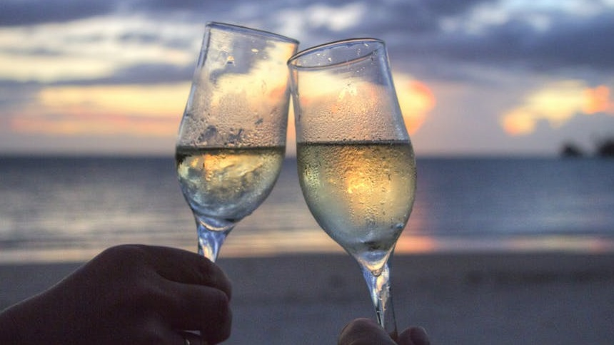 champagne on beach 860x484